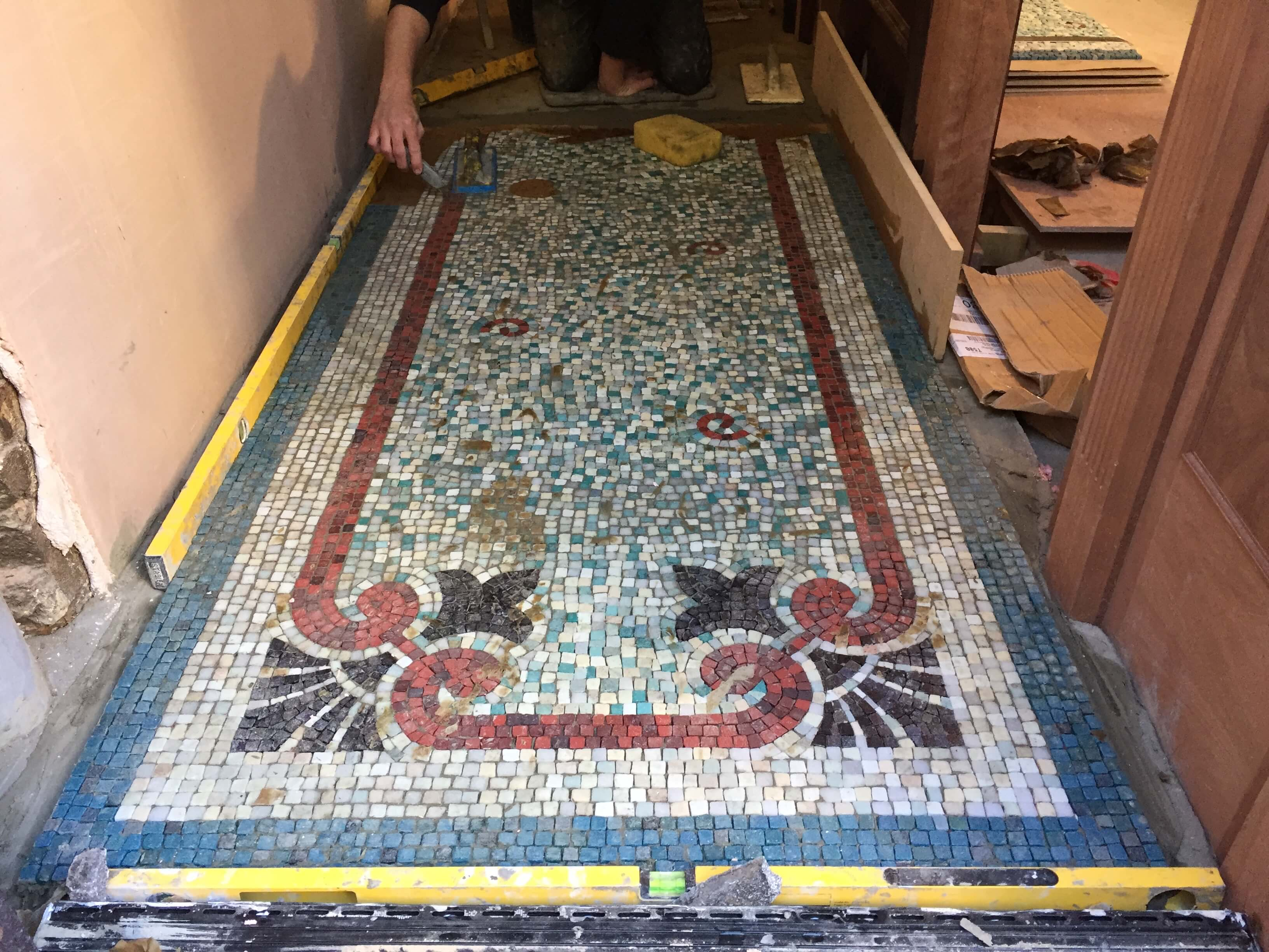 Installing new replica Jesse Rust mosaic to Soho Pub
