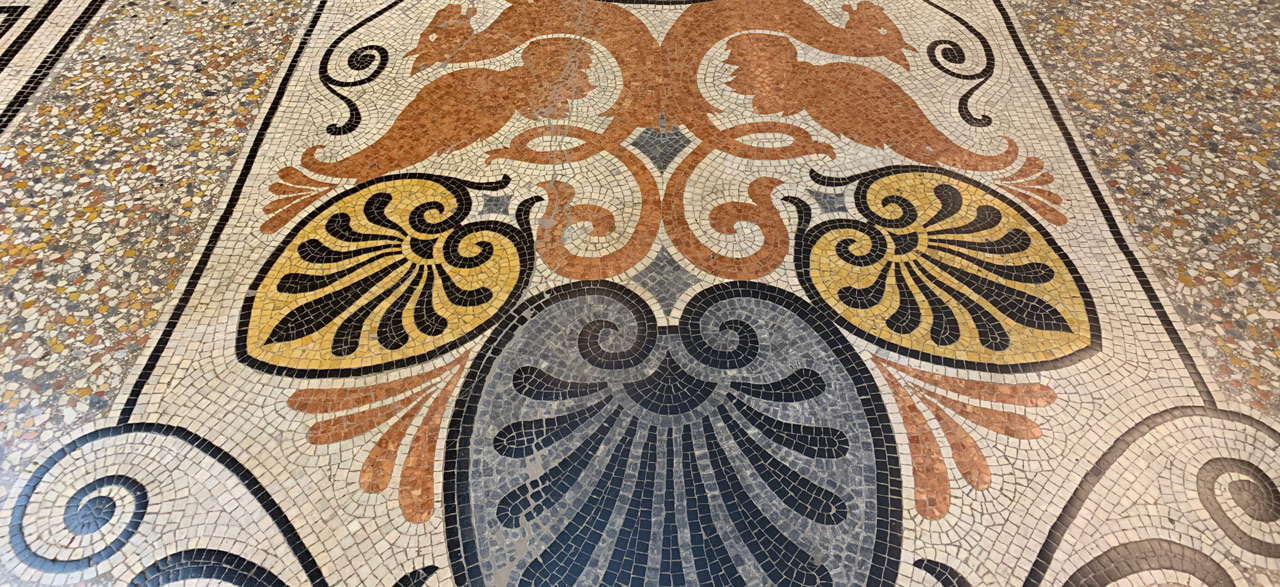 Marble mosaic at the entrance of the Coliseum (ENO), London.